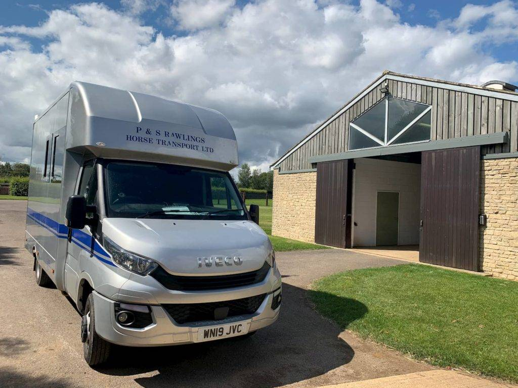 Iveco horse truck next to stables